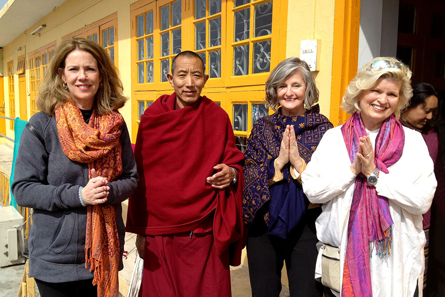 At His Holiness' palace compound with the monk who guards His Holiness' prayer hall, which is not open to the public. Patti Bailey and Rev. Susan Sims Smith, Dharmsala, India, 2013.