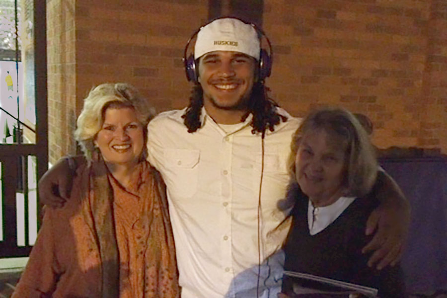 With Elijah Qualls, defensive tackle for University of WA Huskies, and Janet Lawrence, Seattle, WA, 2014